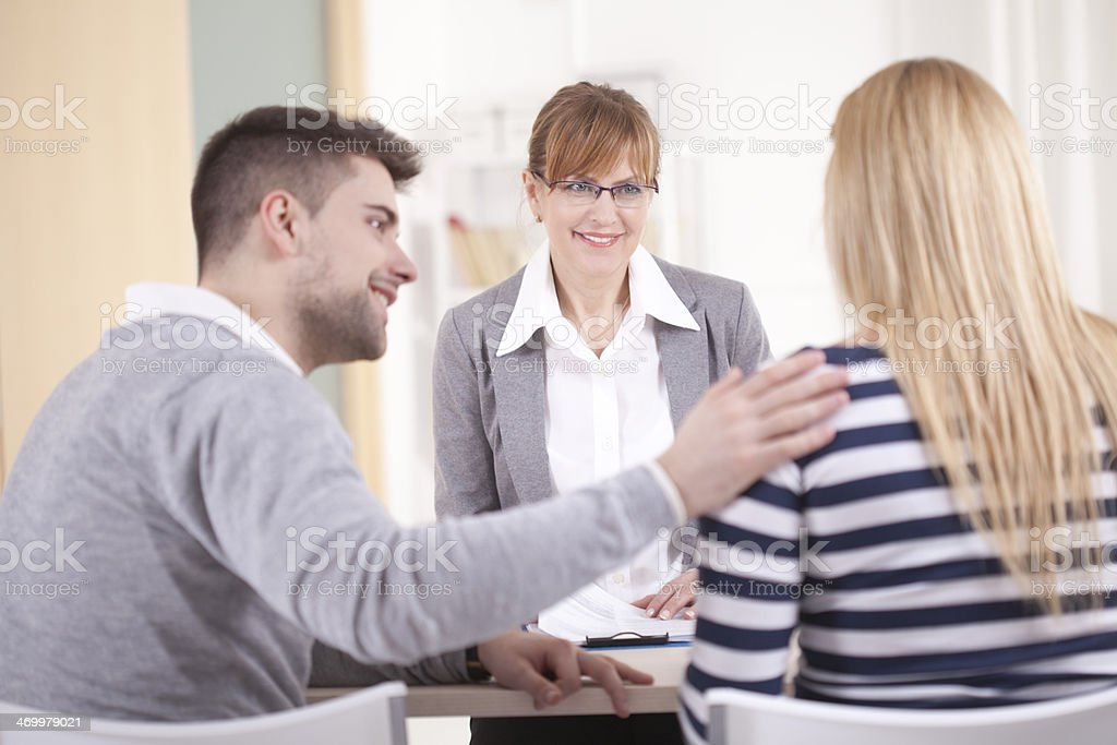 Cheerful psychologist with patients stock photo