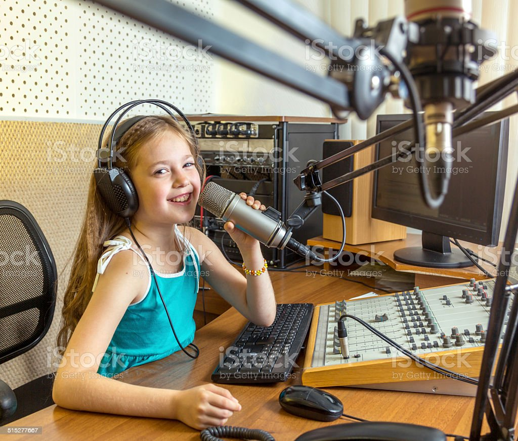 Cheerful radio DJ in live stock photo
