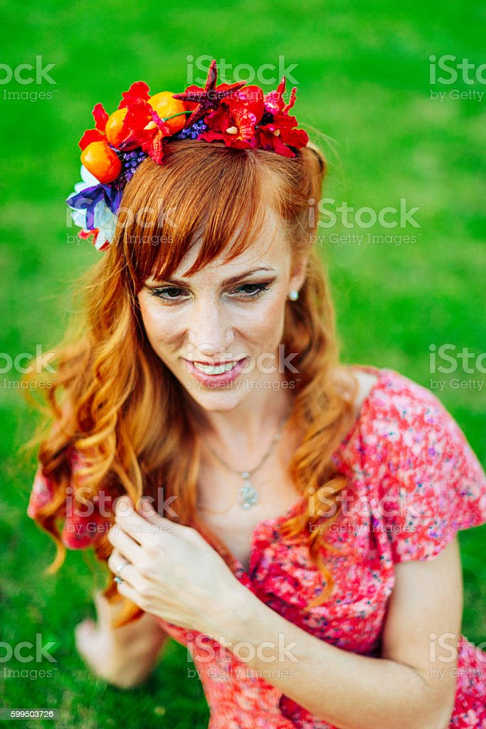 Cheerful red head woman with hair accessory stock photo