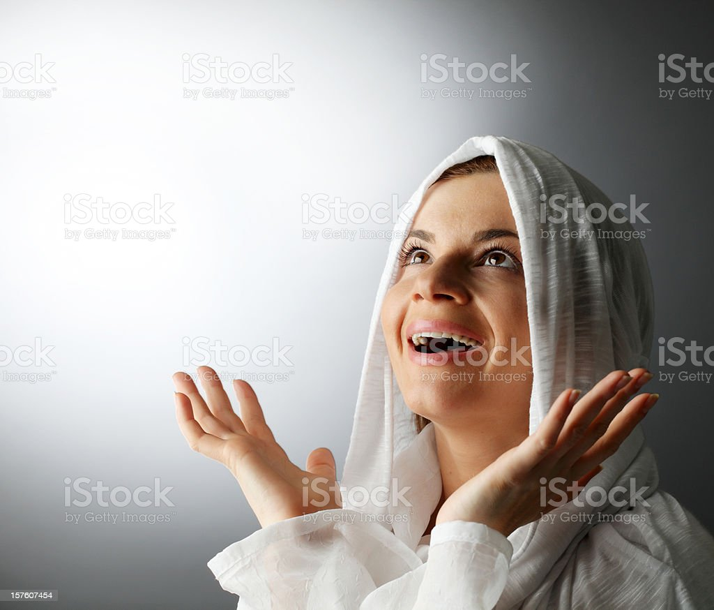 Cheerful religious woman with open hands. royalty-free stock photo