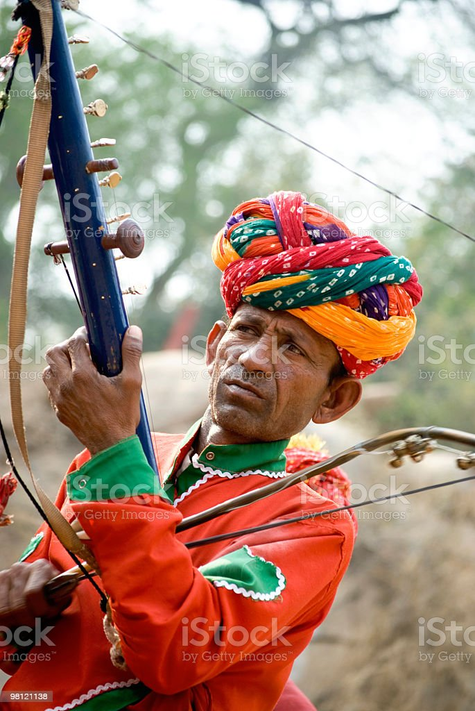 Cheerful Rural Rajasthani Indian Men with a traditional Music Instrument stock photo
