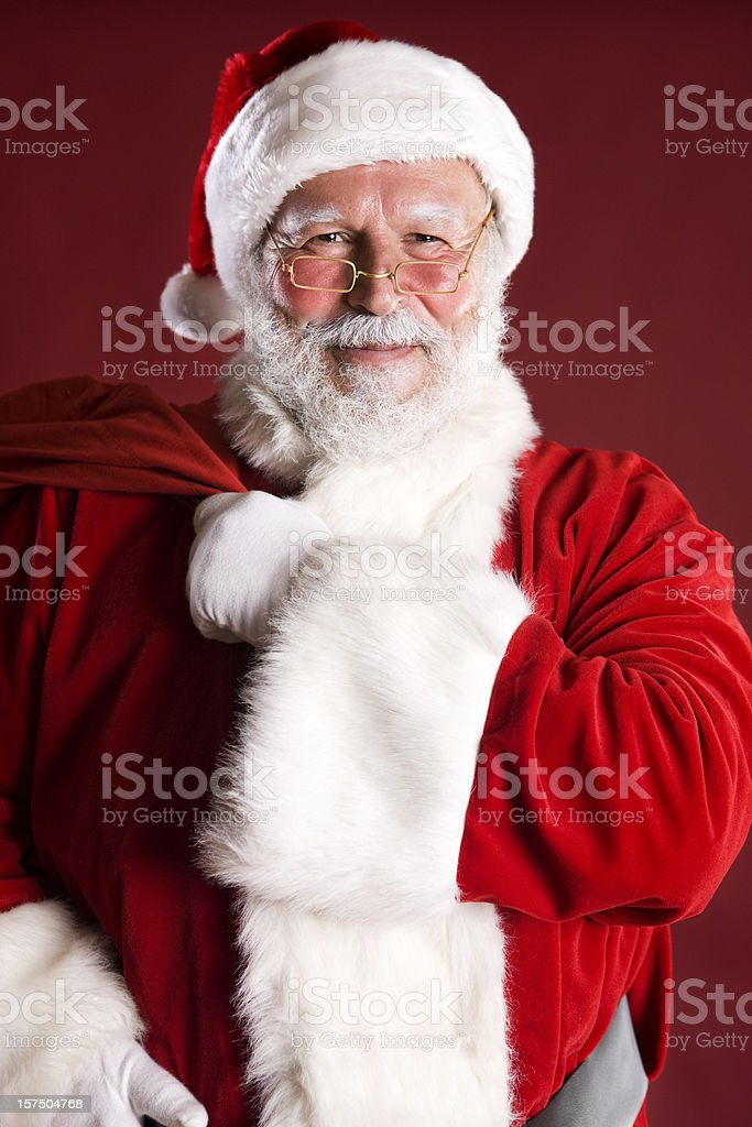 Cheerful Santa Claus Portrait with Bag of Toys Over Shoulder royalty-free stock photo