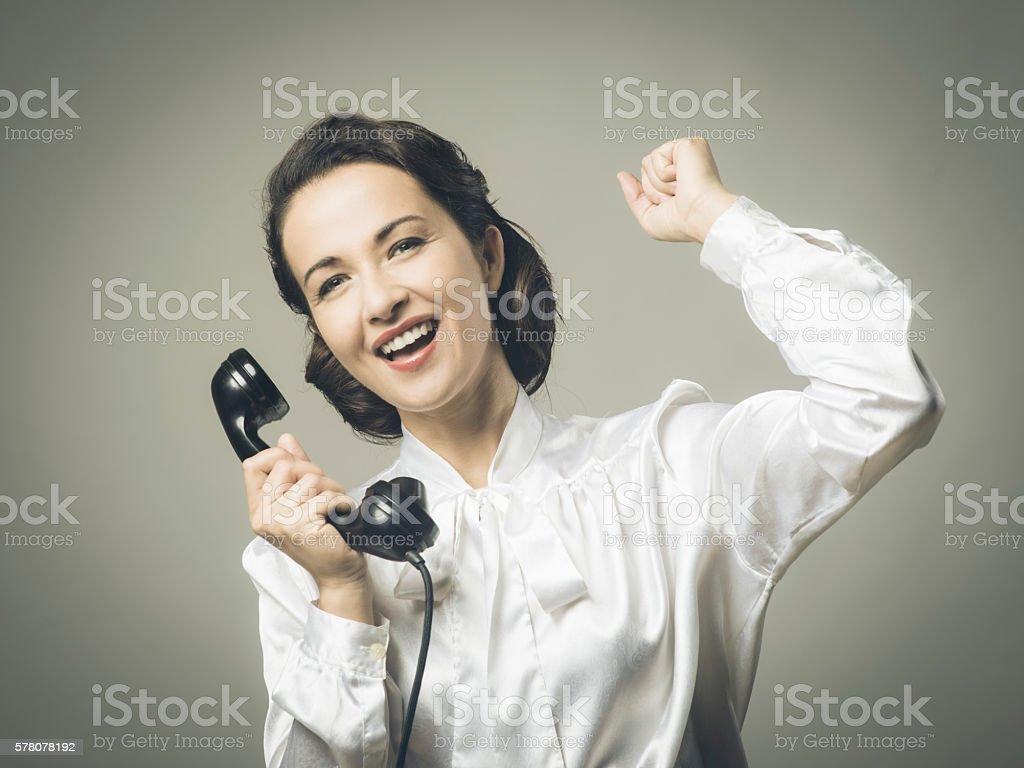 Cheerful secretary on the phone stock photo