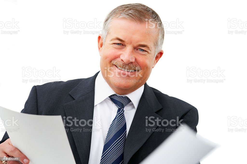 Cheerful senior businessman holding papers royalty-free stock photo
