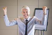 Cheerful Senior Businessman Pumping Fists