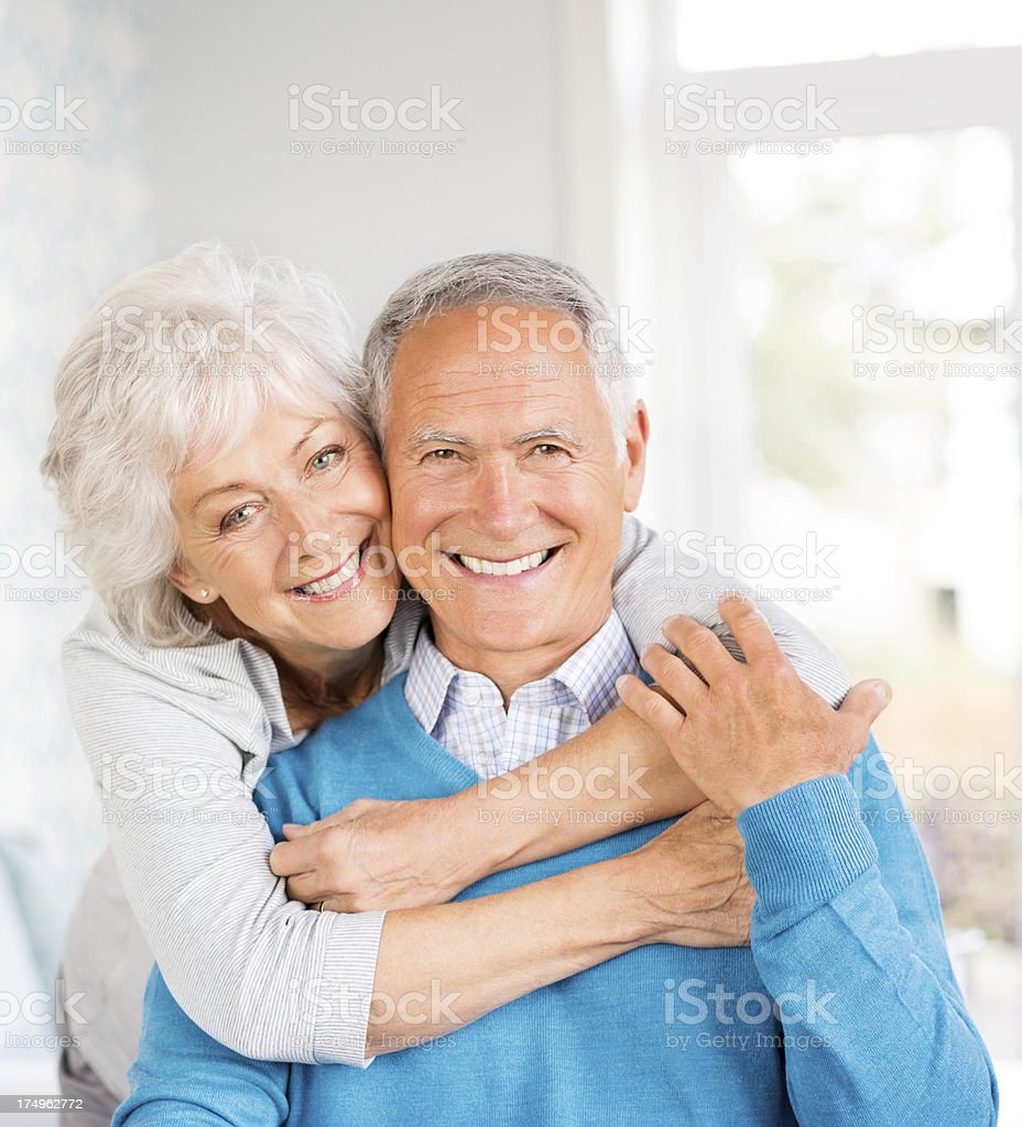 Cheerful Senior Couple Embracing At Home royalty-free stock photo
