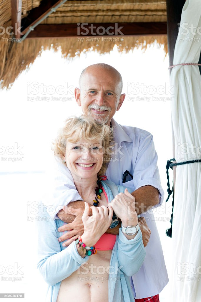 Cheerful Senior Couple Enjoying Summer Day on the Beach royalty-free stock photo