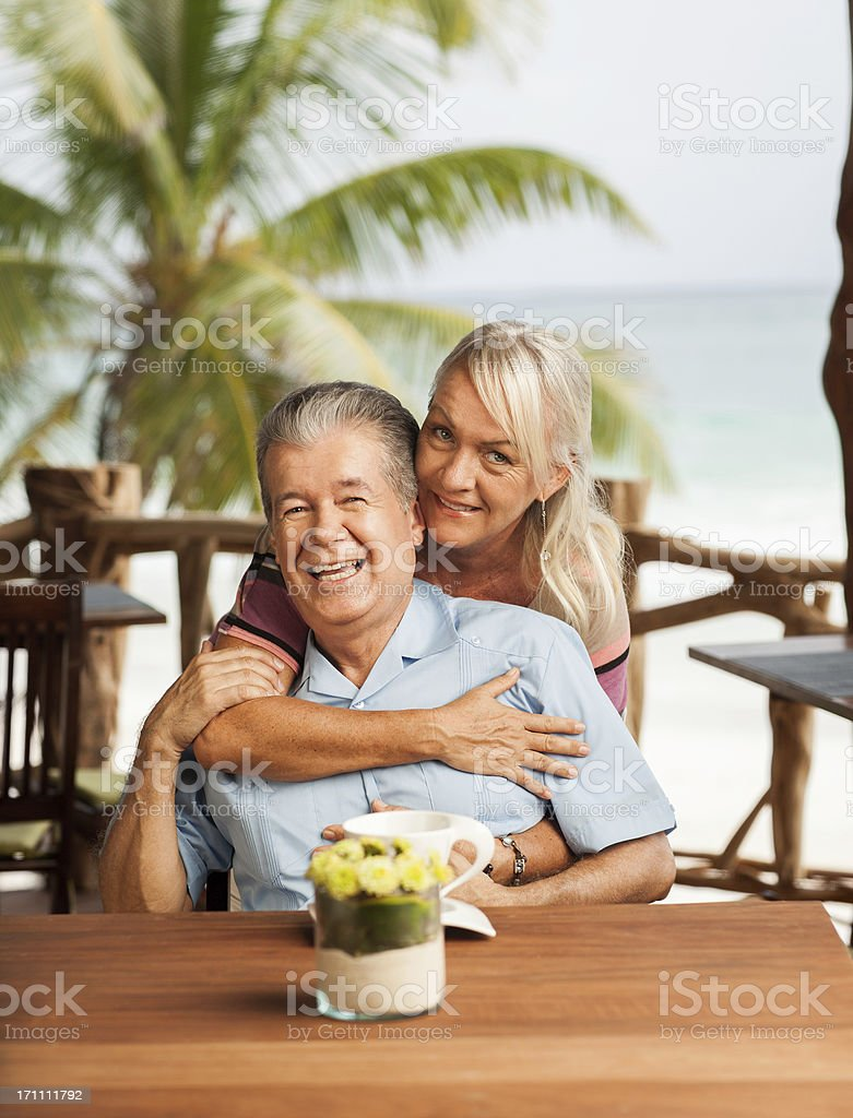 Cheerful senior couple in a restaurant royalty-free stock photo