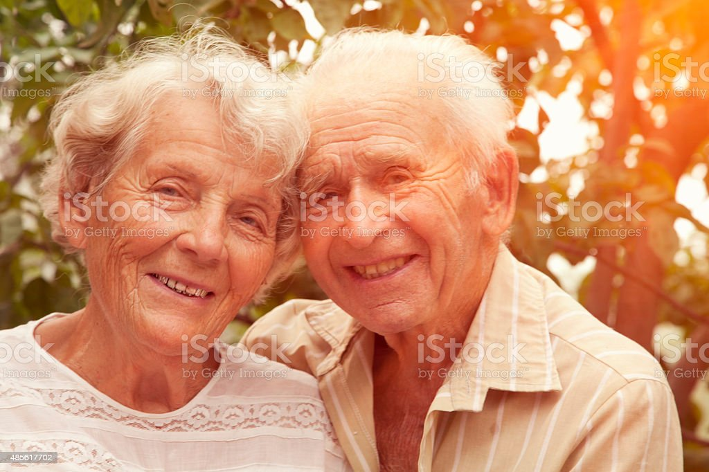 Cheerful Senior couple in the park stock photo