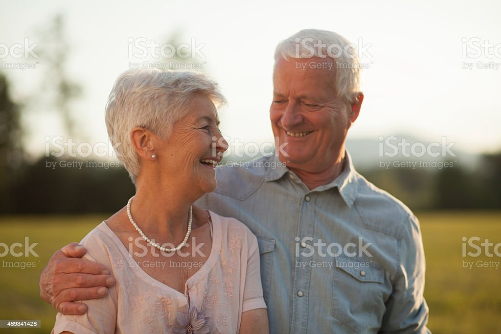 Cheerful senior couple standing together stock photo