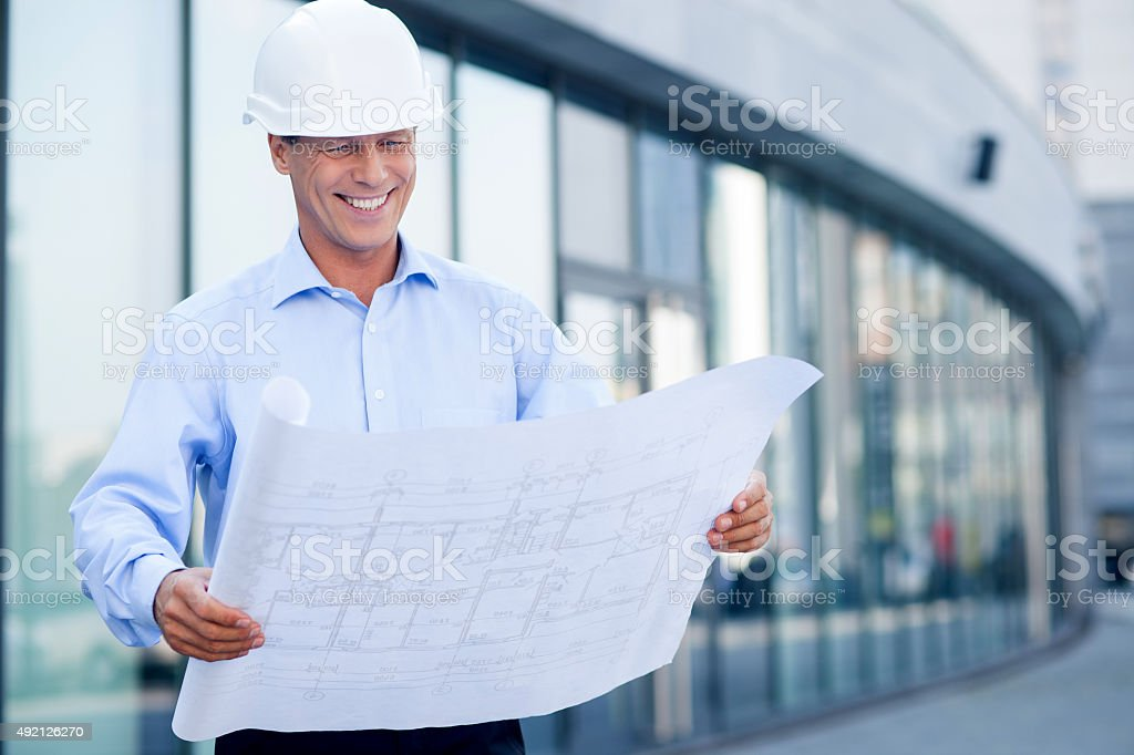 Cheerful senior engineers is working on new project stock photo