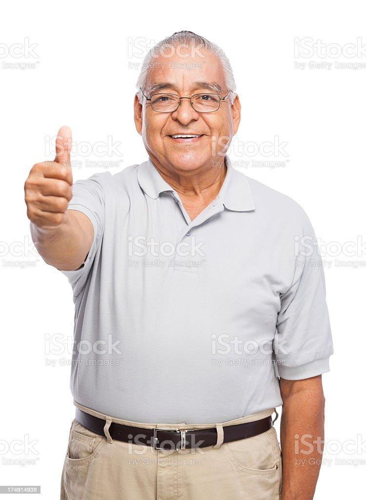 Cheerful senior man making thumbs up royalty-free stock photo