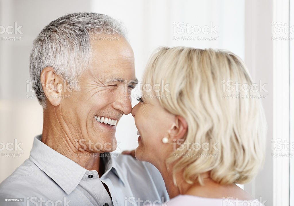 Cheerful senior man with a mature woman spending time together royalty-free stock photo