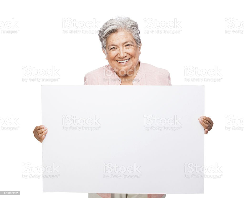 Cheerful senior woman holding a sign royalty-free stock photo