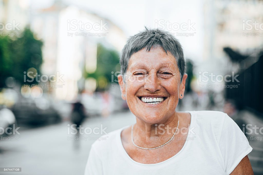 Cheerful senior woman in the summer stock photo