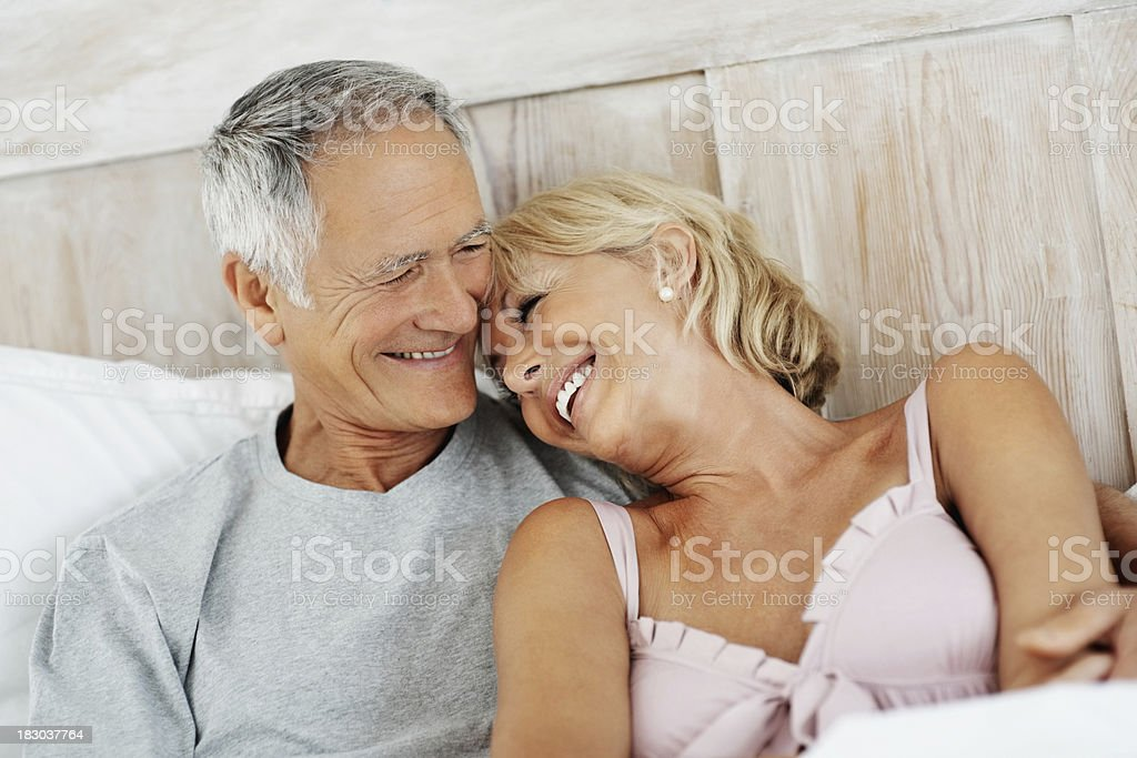 Cheerful senior woman resting on mature man's shoulder royalty-free stock photo