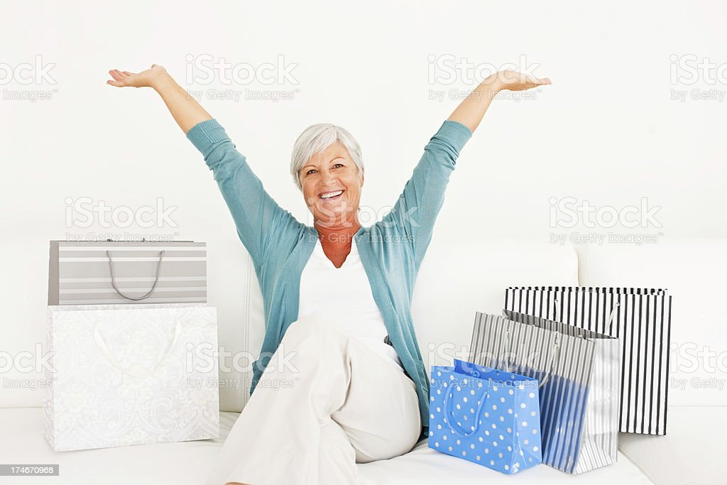 Cheerful senior woman with shopping bags royalty-free stock photo