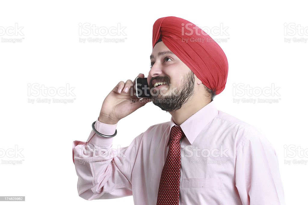 Cheerful Sikh man talking on a mobile phone royalty-free stock photo