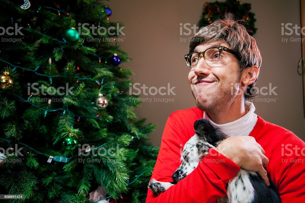 Cheerful silly holiday man playing with his dog stock photo