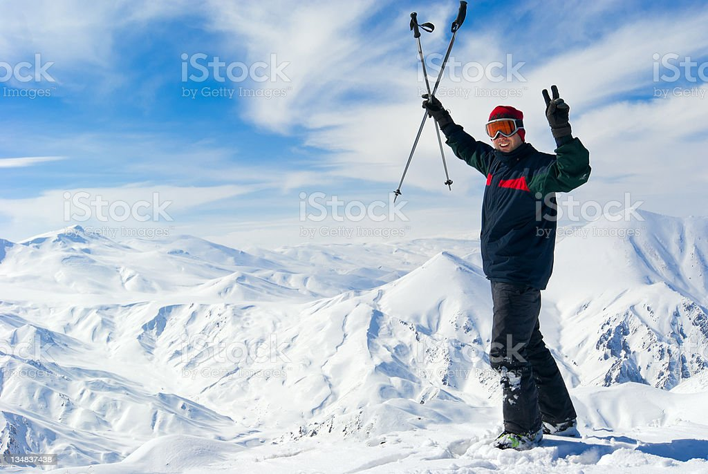 Cheerful skier on the top of mountain royalty-free stock photo