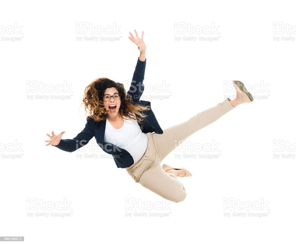 Cheerful smart casual man jumping stock photo