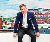 Cheerful smart casual man sitting outdoors