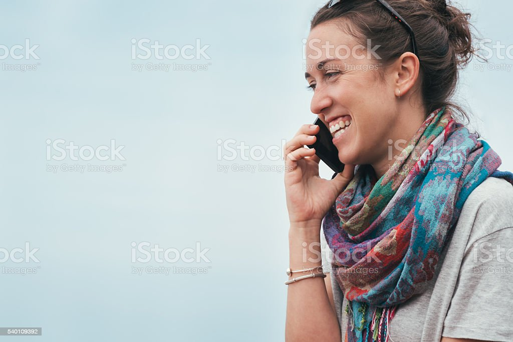 cheerful smiley woman talking on phone stock photo