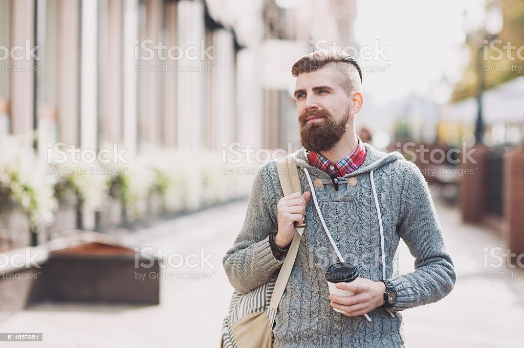Cheerful smiling young man portrait outdoors stock photo