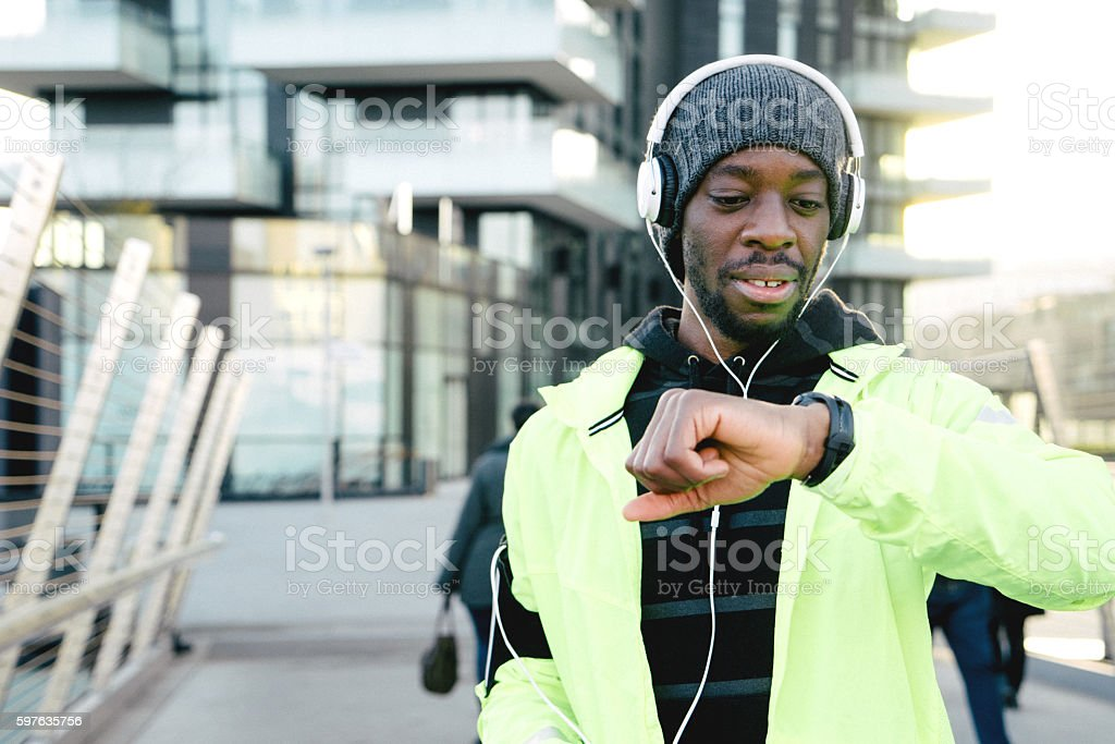 Cheerful Sport Man Looking At His Smart Watch stock photo