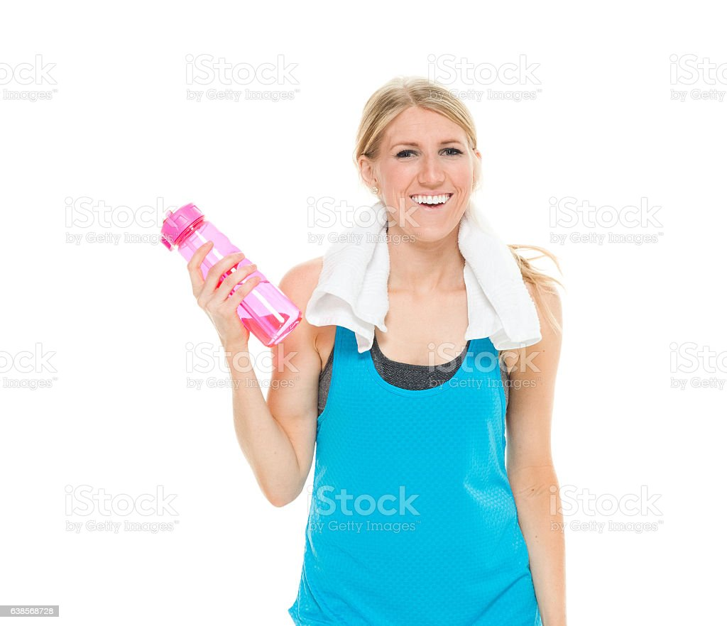Cheerful sports woman holding water bottle stock photo