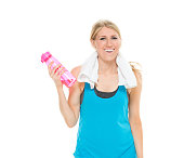 Cheerful sports woman holding water bottle