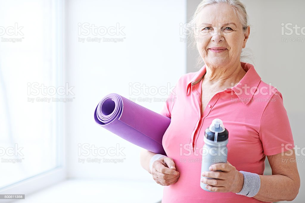 Cheerful sporty senior woman stock photo