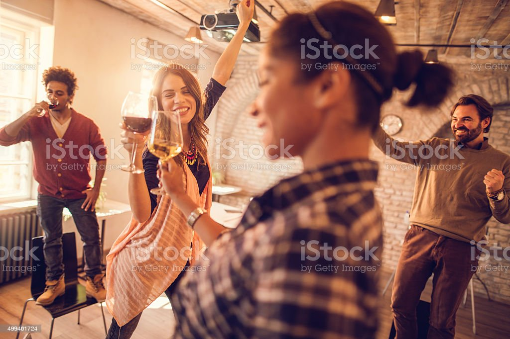 Cheerful start up team having a party at casual office. stock photo