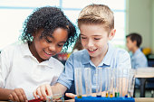 Cheerful STEM school students work on science experiment