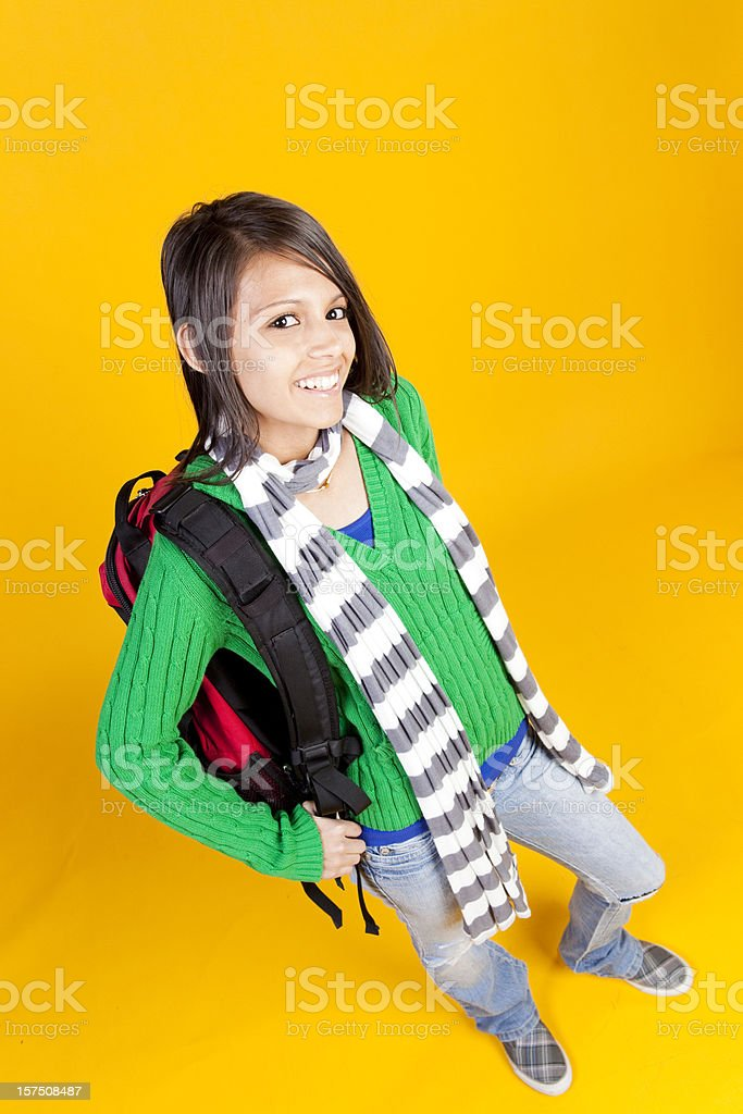 Cheerful student on yellow background royalty-free stock photo