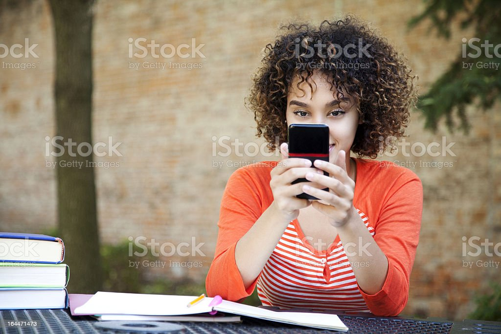 Cheerful student texting royalty-free stock photo