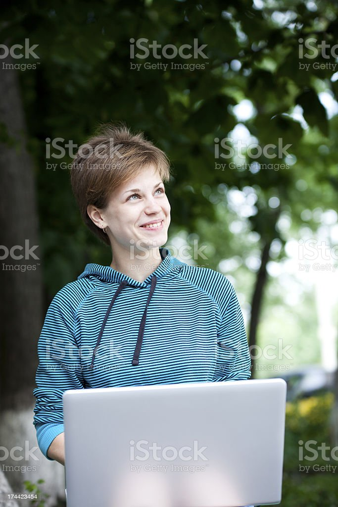 Cheerful Student Using Laptop Outdoors royalty-free stock photo