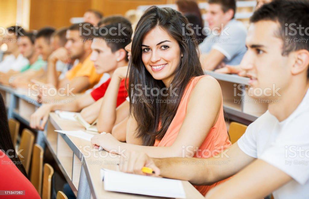 Cheerful students at university amphitheatre royalty-free stock photo