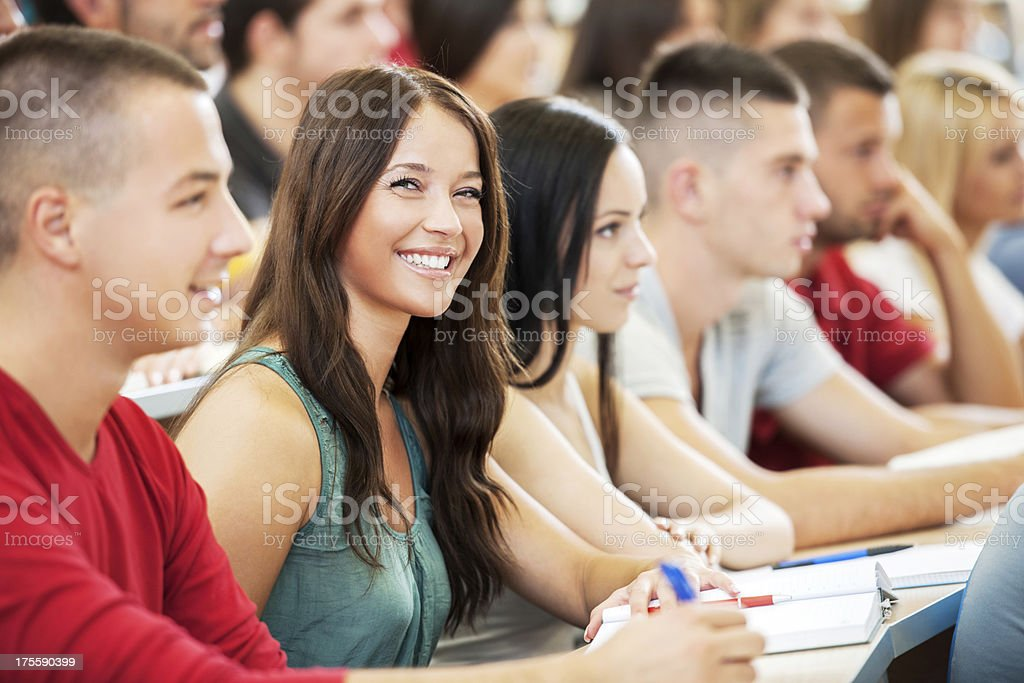 Cheerful students at university amphitheatre royalty-free stock photo