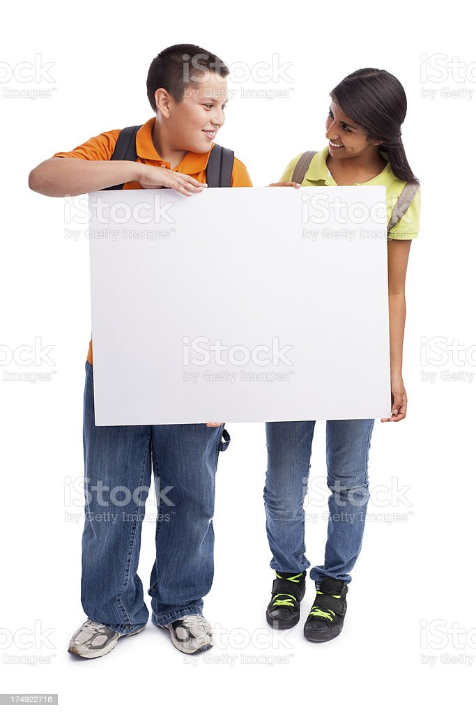 Cheerful students holding a sign royalty-free stock photo