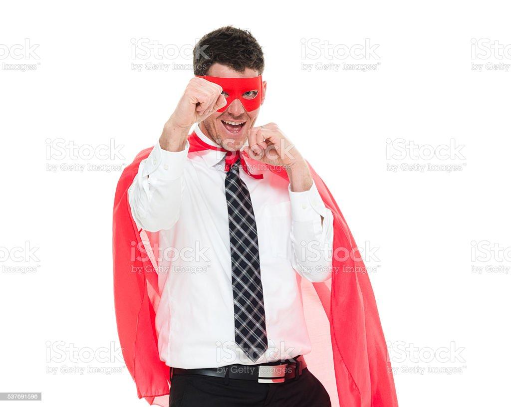 Cheerful superhero in fighting stance stock photo