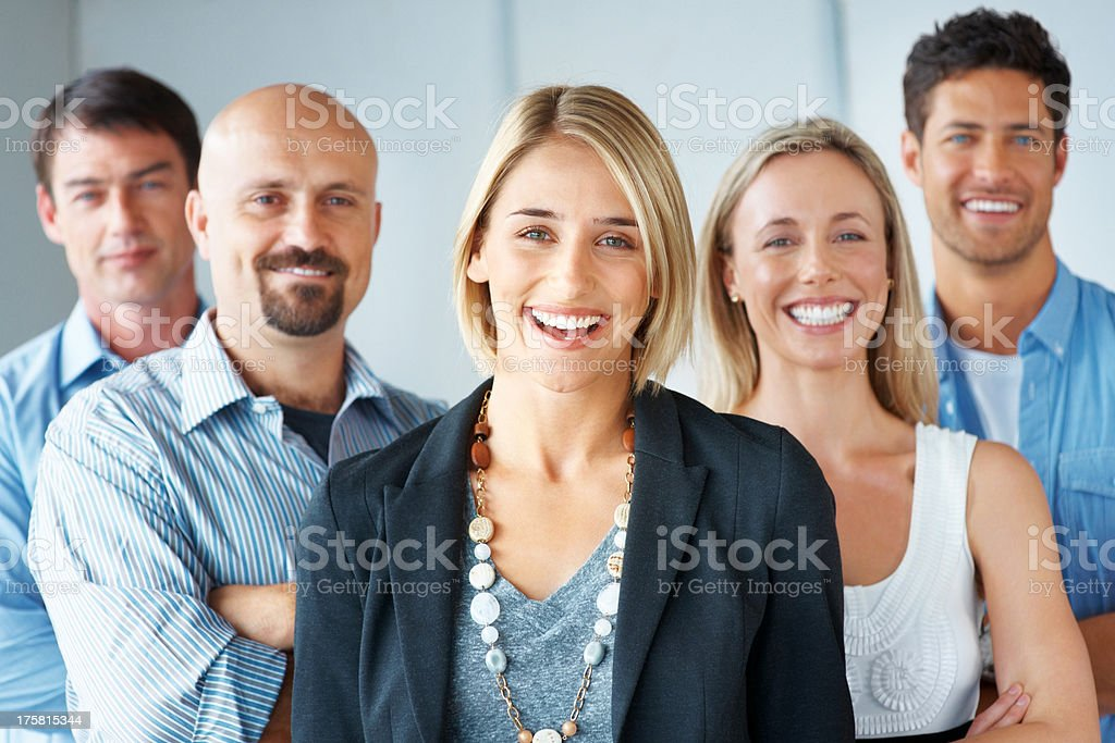 Cheerful team of business people together stock photo