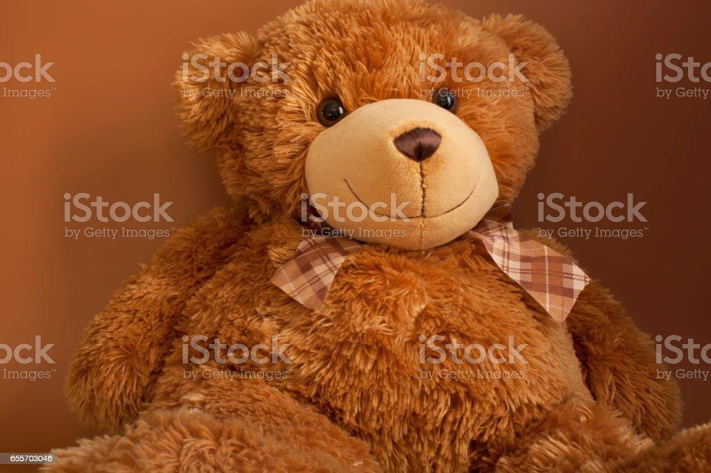 Cheerful Teddy bear stock photo