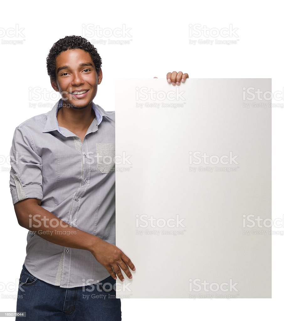 Cheerful teen holding a blank sign royalty-free stock photo