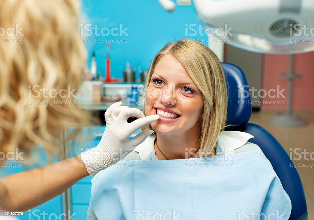 Cheerful Teenage Girl at dentist office. royalty-free stock photo