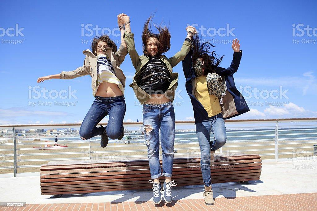 Cheerful teenagers jumping royalty-free stock photo