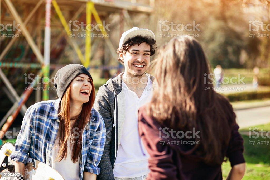 Cheerful teenagers on the playground stock photo