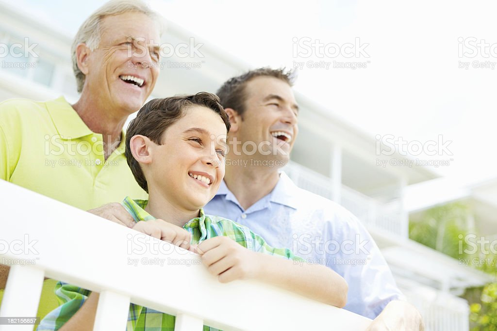 Cheerful three male generation family looking away royalty-free stock photo