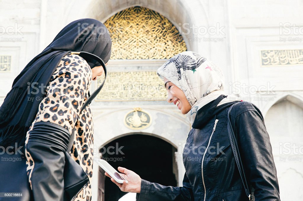 Cheerful Tourist Women Looking At Digital Map In Istanbul, Turkey stock photo
