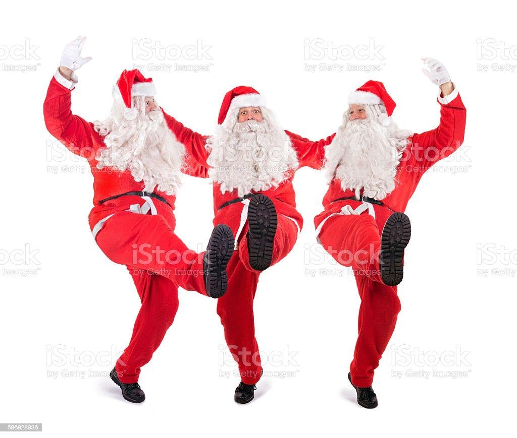 Cheerful Trio Santa Claus stock photo